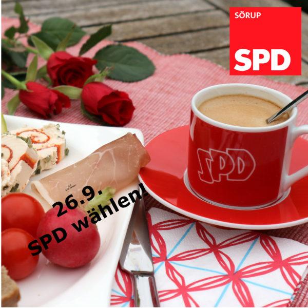 Bild Frühstück mit Kaffee und Brötchen